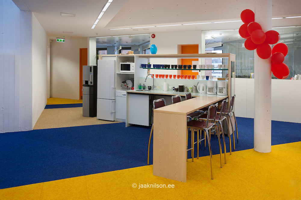 Dining room for Tartu Health Care College staff in Estonia. Canteen, dining room, cafe with table, chairs and. Decorated room with balloons and pillar.