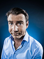 caucasian man frowning sullen portrait isolated studio on black background