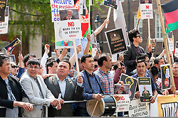 © Licensed to London News Pictures. 12/06/2016. London, UK. Afghan demonstrators gather in Pall Mall to make their views known as Prime Minister, David Cameron, and other G20 leaders meet in nearby Lancaster House for the Anti-Corruption Summit 2016. Photo credit : Stephen Chung/LNP