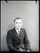 vintage formal studio portrait of young adult man, circa 1930s