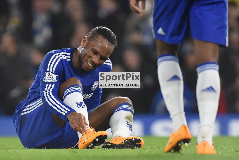 Ankle problem for Chelsea FW Didier Drogba (11) at the end of the first half during Chelsea v Tottenham Hotspur, Barclays Premier League, 3 December 2014 at Stamford Bridge Stadium, London, England (c) Salvio Calabrese | SportPixPix.org.uk