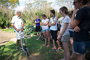 Art Trese, associate environmental and plant biology professor, leads the sustainable agriculture class in the West State Street Gardens.