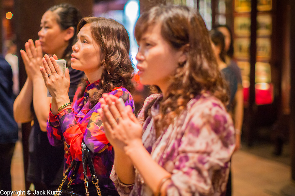 05 APRIL 2012 - HANOI, VIETNAM:   Teachers and educators pray for their students at the Temple of Literature in Hanoi, the capital of Vietnam. The Temple of Literature (Vietnamese: Vn Miu, Hán t) is a temple of Confucius in Hanoi, northern Vietnam. The compound also houses the Imperial Academy (Quc T Giám). The temple also functioned as Vietnam's first university. The temple was first constructed in 1070 under King Lý Nhân Tông and is dedicated to Confucius, sages and scholars.   PHOTO BY JACK KURTZ