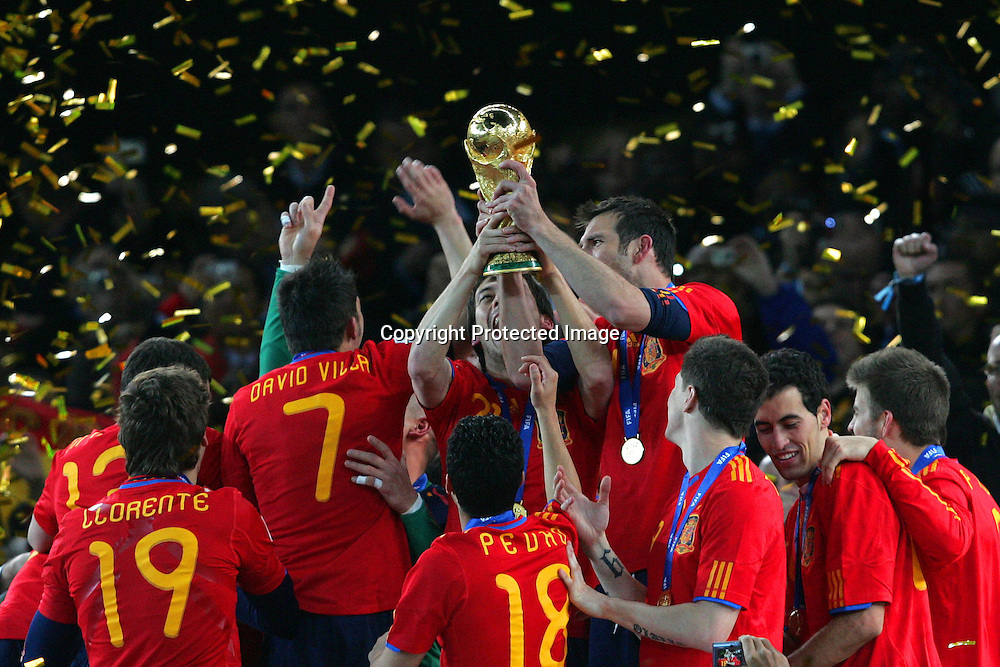 Spain celebrate with the trophy during the Final match of the FIFA World Cup 2010 between The Netherlands and Spain held at The Soccer City Stadium in SOWETO, Johannesburg, South Africa on the 11 July 2010...Photo by Ron Gaunt/SPORTZPICS