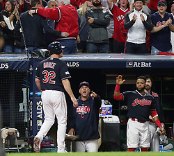 October 11, 2017 - Cleveland, OH, USA - The Cleveland Indians' Jay Bruce, left, is congratulated by manager Terry Francona after scoring on single by Roberto Perez in the fifth inning against the New York Yankees during Game 5 of the American League Division Series, Wenesday, Oct. 11, 2017, at Progressive Field in Cleveland. (Credit Image: © Phil Masturzo/TNS via ZUMA Wire)