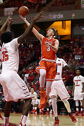21 November 2015: Asa Cantwell(3) lifts the ball between the arms of Roland Griffin(35). Illinois State Redbirds host the Houston Baptist Huskies at Redbird Arena in Normal Illinois (Photo by Alan Look)
