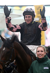 Harry Skelton celebrates victory at the Randox Health County Handicap Hurdle during Gold Cup Day of the 2019 Cheltenham Festival at Cheltenham Racecourse.