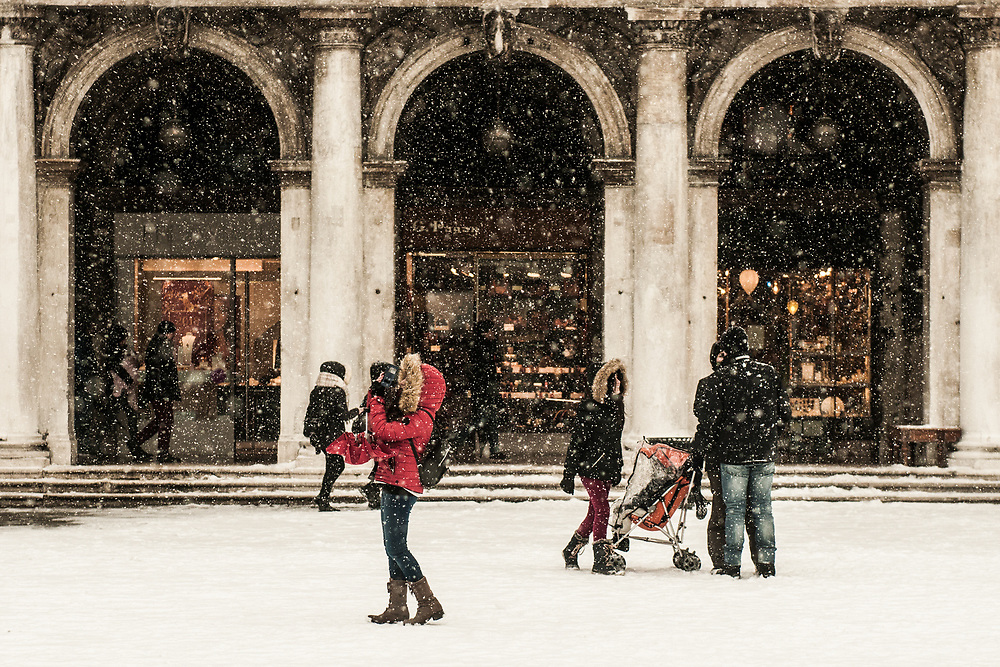 VENICE, ITALY - 28th FEBRUARY/01st MARCH 2018<br /> Tourists enjoy the atmosphere created by a snowfall in Saint Mark square in Venice, Italy. A blast of freezing weather called the &ldquo;Beast from the East&rdquo; has gripped most of Europe in the middle of winter of 2018, and in Venice A snowfall has covered the city with white, making it fascinating and poetic for citizen and tourists.   &copy; Simone Padovani / Awakening