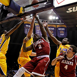 February 11, 2012; Baton Rouge, LA; Alabama Crimson Tide guard Charles Hankerson Jr. (2) has his shot blocked by LSU Tigers center Justin Hamilton (41) during the first half of a game at the Pete Maravich Assembly Center.  Mandatory Credit: Derick E. Hingle-US PRESSWIRE
