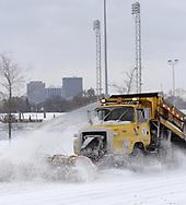 A city of Dayton snowplow cruises by Welcome Stadium near the University of Dayton Arena, January 21, 2007.