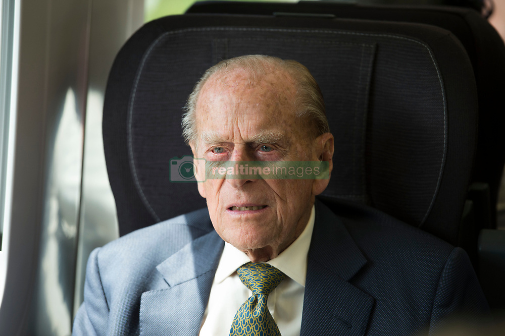 The Duke of Edinburgh on a train travelling from Slough to Paddington Station to mark the 175th anniversary of the first train journey by a British monarch.