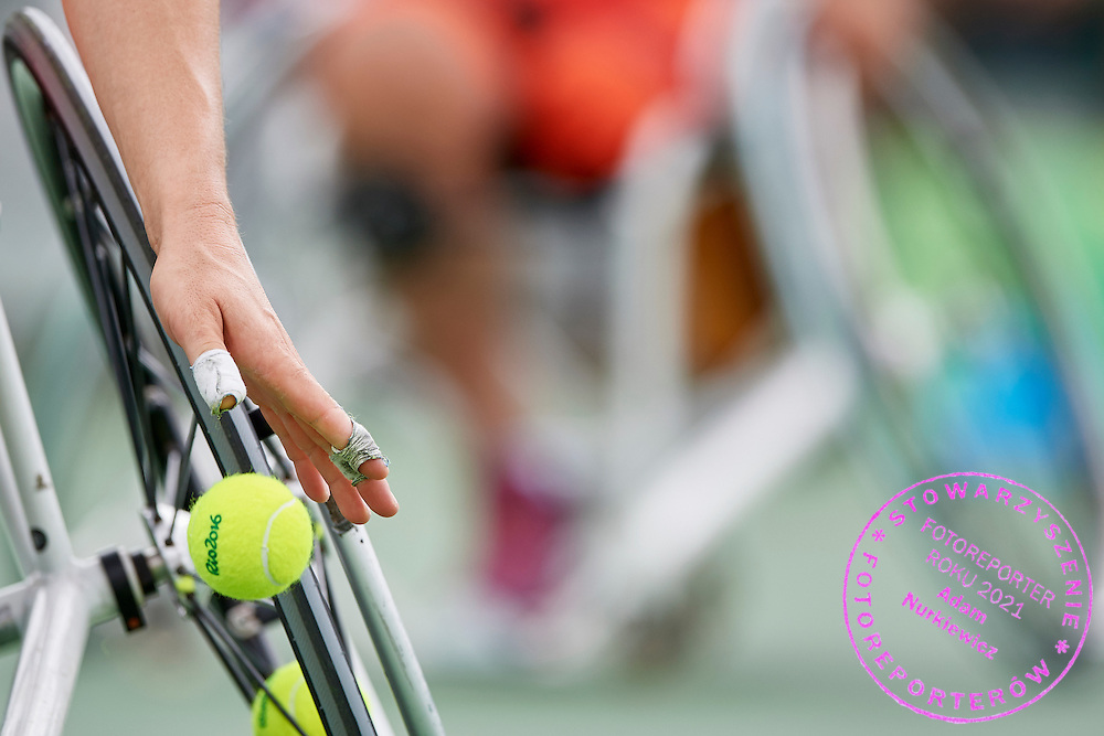 Rio de Janeiro, Brazil - 2016 September 10: Kamil Fabisiak from Poland competes in Wheelchair Tennis - Men's Doubles First Round on Court Nr 9 at Olympic Tenis Centre during 2016 Summer Paralympic Games on September 10, 2016 in Rio de Janeiro, Brazil.<br /> <br /> Adam Nurkiewicz declares that he has no rights to the image of people at the photographs of his authorship.<br /> <br /> Picture also available in RAW (NEF) or TIFF format on special request.<br /> <br /> Any editorial, commercial or promotional use requires written permission from the author of image.<br /> <br /> Mandatory credit:<br /> Photo by &copy; Adam Nurkiewicz / Mediasport