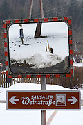 Easter in Southern Styria, Austria. Kitzeck in the snow. Traffic mirror.