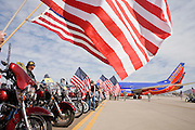 "30 MARCH 2008 -- PHOENIX, AZ: Members of the Patriot Guard Riders line the tarmac in Phoenix, AZ, as a Southwest Airlines charter bringing Arizona National Guard soldiers home arrives in Phoenix Sunday. About 250 members of the Arizona Army National Guard's 158th Infantry Battalion returned to Phoenix, AZ, from a year long deployment in Afghanistan Sunday. The unit, also known as the ""Bushmasters"" from their service in World War II, was part of the largest single-unit deployment of the Arizona National Guard since the second World War. Two members of the battalion were killed in action during their deployment. The battalion, a combat unit, engaged in counter insurgency operations through out their deployment. Photo by Jack Kurtz / ZUMA Press"