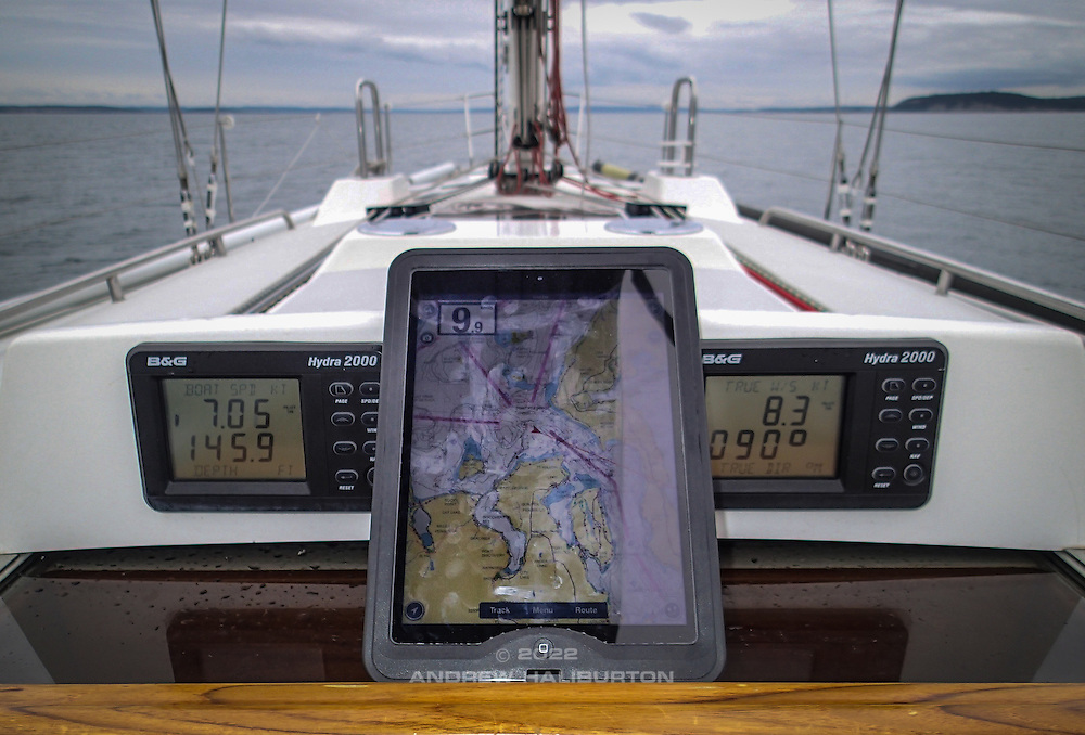 Flood tide, cold, calm and raining.  I post watch and helm remotely from the warmth of the cabin, surrounded by the marvels of modern navigation.  The crew sleeps deeply.  2.8 knots of fair current helps deliver Riva to Shilshole Bay Marina, Seattle.  Aboard J/46 Riva, with Scott Campbell and Nelson Rolens.  2014 Swiftsure International Yacht Race, Victoria, British Columbia, Canada.  Olympus Tough TG-1.