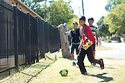 Yogesh Acharya (13) runs ahead of Roshan Diyali (13), Roshan Biswa (13) as they walk home to the Ivy Apartments where Thomas E. Duncan, the first confirmed Ebola virus patient in the United States, was staying with family in Dallas, Texas on October 4, 2014. Duncan is now being treated at Texas Health Presbyterian Hospital Dallas while members of his family have been isolated in the apartment. (Cooper Neill for The New York Times)