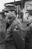 Friedberg, Germany 1958.<br /> Presley in his GI fatigues.<br /> <br /> <br /> Friedberg , Allemagne 1958 .<br /> Presley dans son uniforme de soldat americain.