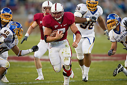 September 19, 2009; Stanford, CA, USA;  Stanford Cardinal running back Toby Gerhart (7) rushes past San Jose State Spartans safety Tiuke Tuipulotu (40) during the second quarter at Stanford Stadium. Stanford defeated San Jose State 42-17.