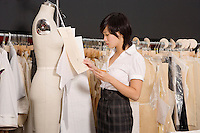 Side view of woman working in her clothing store