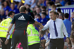 LIVERPOOL, ENGLAND - Saturday, October 1, 2011: Liverpool's manager Kenny Dalglish and Everton's manager David Moyes after the Premiership match at Goodison Park. (Pic by Vegard Grott/Propaganda)
