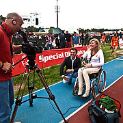 Italy, Biella- Italian National Games 2012 - Opening Ceremony-Capirossi motorcycle champion and testimonial game, he's interviewed by disability channel journalist