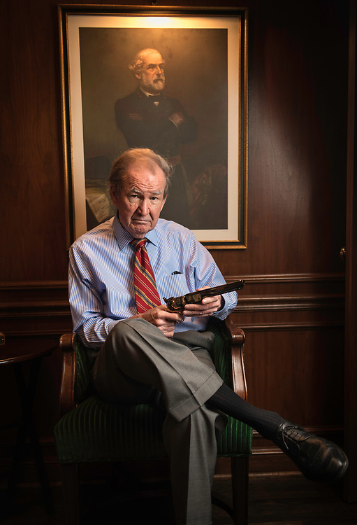 MCLEAN, VA -- 3/21/17 -- Buchanan holds his Robert E. Lee replica revolver as he sits for a photo under the portrait of the Confederate general. His family fought for the Confederacy. Respected conservative commentator Pat Buchanan reflects on his career at his home in McLean. .…by André Chung #_AC24170