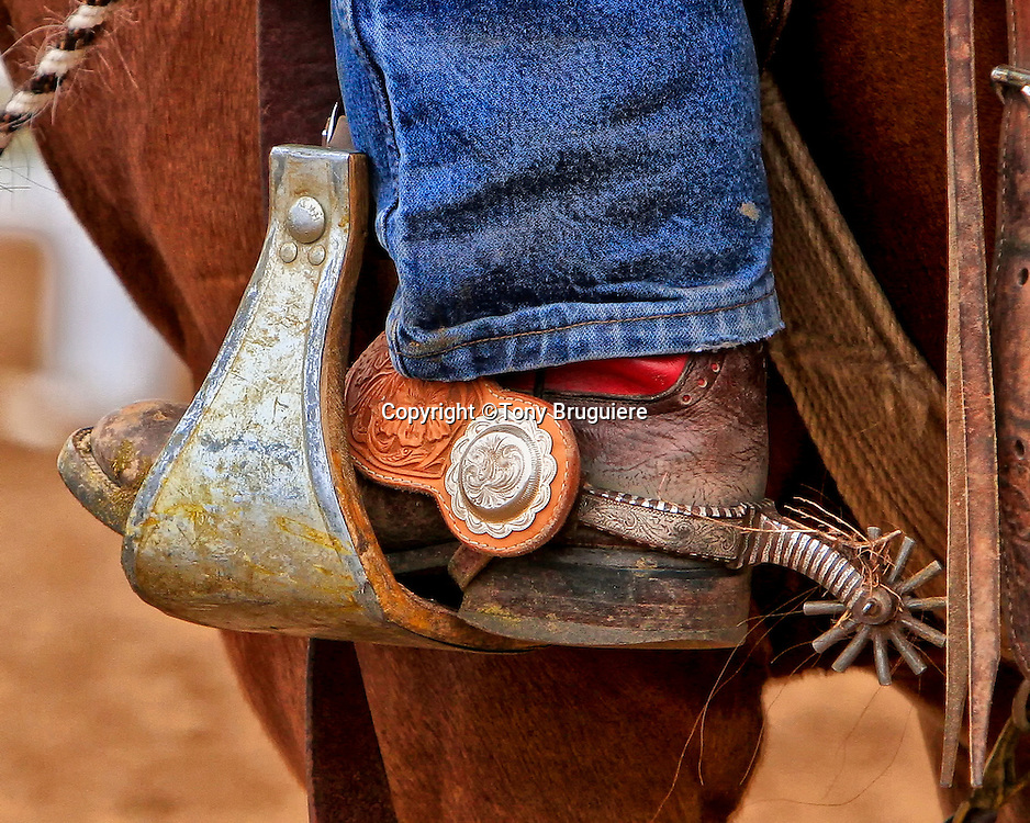 Buckaroo spurs are usually more ornate and have larger rowels (round part) than a Texas cowboy.