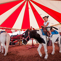 090513       Cable Hoover<br /> <br /> Sia Begay takes a spin on the pony ride at the Navajo Nation Fair in Window Rock Thursday.