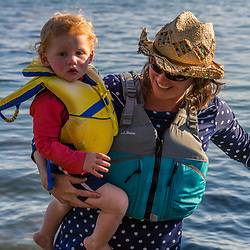 A woman carries her young son ashore on East Gosling Island in Casco Bay, Harpswell, Maine.