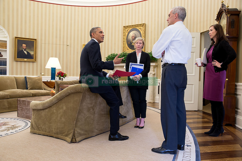 President Barack Obama talks with Chief of Staff Denis McDonough, Anita Decker Breckenridge, Deputy Chief of Staff for Operations, and Katie Beirne Fallon, Director of Legislative Affairs, right, in the Oval Office, Nov. 5, 2014. (Official White House Photo by Pete Souza)<br /> <br /> This official White House photograph is being made available only for publication by news organizations and/or for personal use printing by the subject(s) of the photograph. The photograph may not be manipulated in any way and may not be used in commercial or political materials, advertisements, emails, products, promotions that in any way suggests approval or endorsement of the President, the First Family, or the White House.