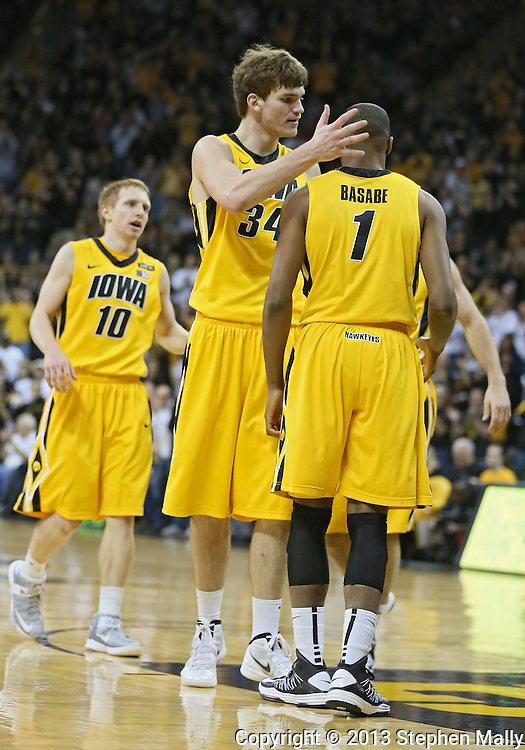 January 19 2013: Iowa Hawkeyes center Adam Woodbury (34) congratulates forward Melsahn Basabe (1) during the first half of the NCAA basketball game between the Wisconsin Badgers and the Iowa Hawkeyes at Carver-Hawkeye Arena in Iowa City, Iowa on Sautrday January 19 2013. Iowa defeated Wisconsin 70-66.