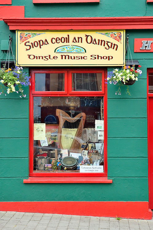 The Irish harp pride of place in the window of the Dingle Music Shop. Dingle town on the Dingle Peninsula, County Kerry, Ireland