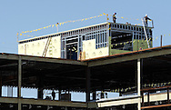 Newburgh, New York - Workers stand on the roof as construction continues on Kaplan Hall at Orange County Community College's Newburgh campus on March 17, 2010. Kaplan Hall will be a state-of-the-art, environmentally friendly building.