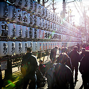 TOKYO, JAPAN - JANUARY 1 : People visit Sensoji Buddhist temple at the Asakusa district in Tokyo to offer New Year prayers on Sunday, January 1, 2017. Japan celebrated the start of 2017 for the Year of the Rooster. (Photo by Richard Atrero de Guzman/NURPhoto)