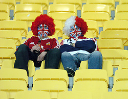 LIONS FANS SIT DEJECTED IN THE STANDS AFTER THEIR TEAM LOSE THE SERIES 2-0 AGAINST THE ALL BLACKS.NEW ZEALAND V BRITISH & IRISH LIONS, 2ND TEST, WESTPAC STADIUM, WELLINGTON, NEW ZEALAND, SATURDAY 3RD JULY 2005.