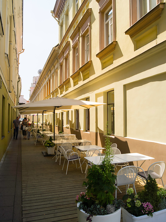 Tables wait for lunch in an alley off of Vokieciu street/gatve, Vilnius, Lithuania