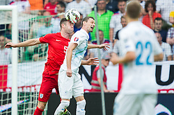 Gary Cahill of England vs Milivoje Novakovic of Slovenia during the EURO 2016 Qualifier Group E match between Slovenia and England at SRC Stozice on June 14, 2015 in Ljubljana, Slovenia. Photo by Vid Ponikvar / Sportida