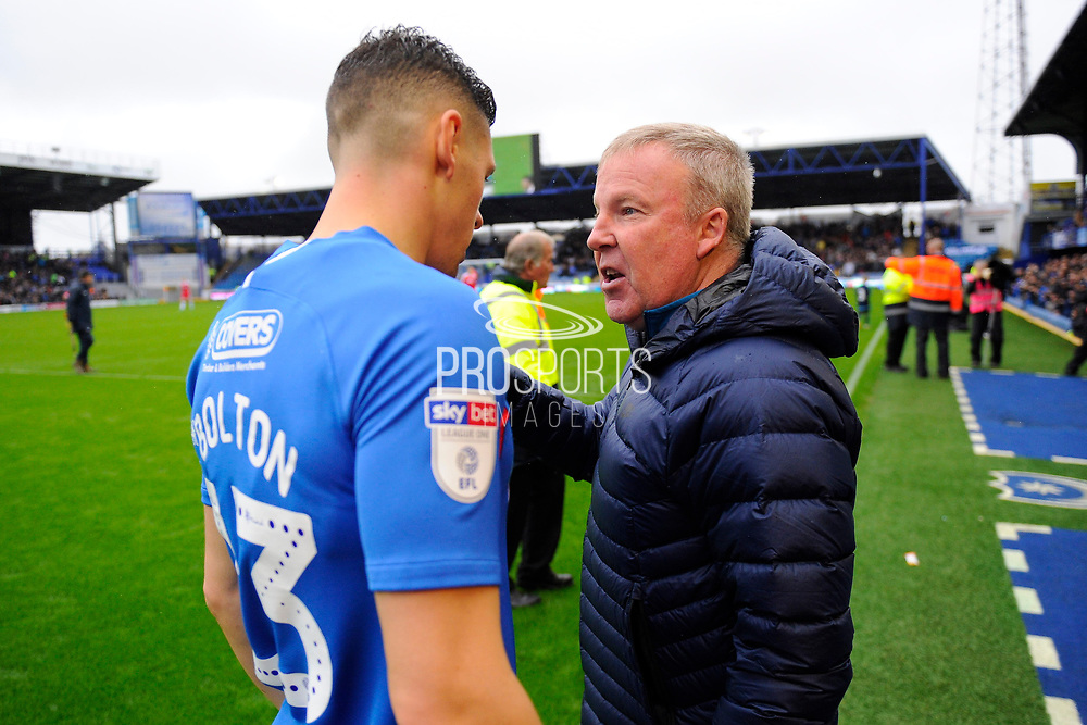 Portsmouth manager Kenny Jackett talks to James Bolton (13) of Portsmouth before kick off during the EFL Sky Bet League 1 match between Portsmouth and Gillingham at Fratton Park, Portsmouth, England on 12 October 2019.