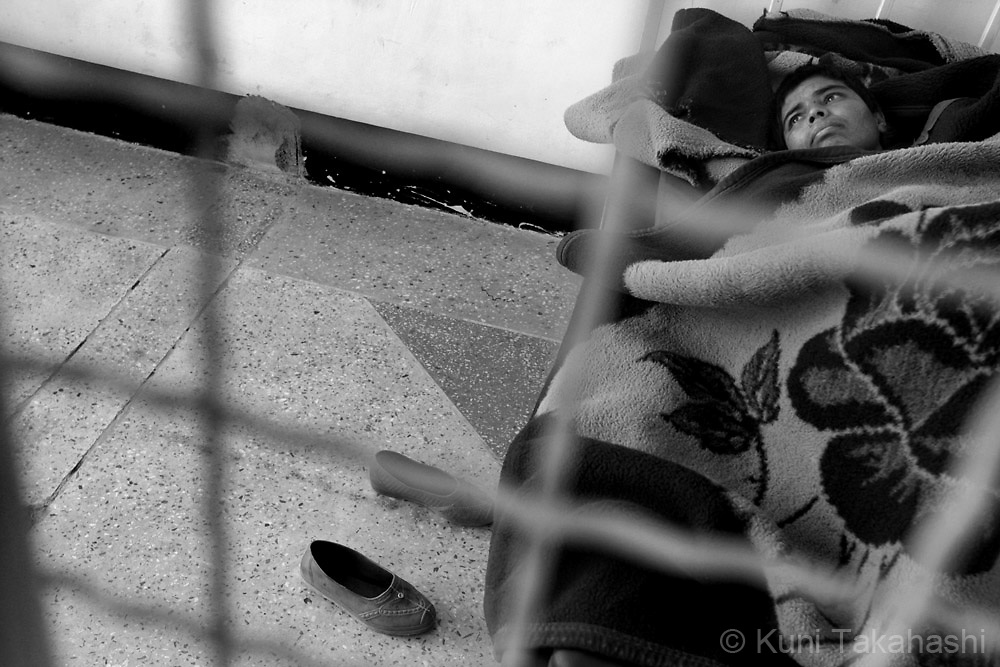 A mentally ill patient lies on her bed behind a fence at a mental health clinic operated by the Red Crescent in Kabul, Afghanistan on Nov 16, 2008. Many patients were brought to the facility because they don't have family members to take care of them.