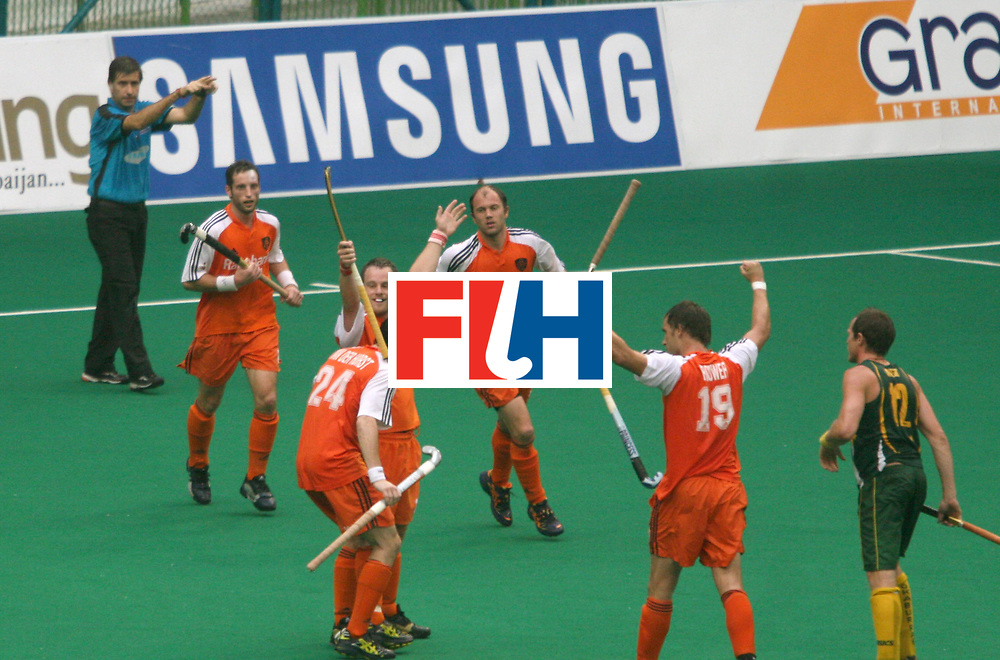 Kuala Lumpur :  Taeke Taekama of Netherlands celebrates his second goal against Australia in the Samsung Hockey Men Champions Trophy at the National Stadium, Bukit Jalil, Malaysia on 06 Dec 2007. Australia drew with Netherlands 3-3.<br /> This match is the 500th match in the history of the Champion trophy.<br /> Photo:GNN/Vino John