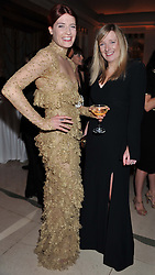 Left to right, FLORENCE WELCH and SARAH BURTON at the Harper's Bazaar Women of the Year Awards 2011 held at Claridge's, Brook Street, London on 7th November 2011.