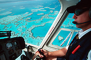 Helicopter flight over the Great Barrier Reef, Heart Reef visible next to the pilot.