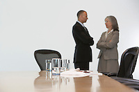 Business couple standing by conference table focus on table
