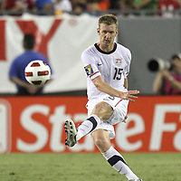 USA defender Tim Ream (15) kicks the ball during a  CONCACAF Gold Cup soccer match between the United States and Panama on Saturday, June 11, 2011, at Raymond James Stadium in Tampa, Fla. (AP Photo/Alex Menendez)