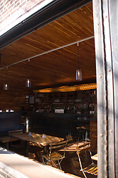 Interior shots of Dram bar Brooklyn, NY.  Wood paneling, bar, Tom Chadwick, open window, Wide open space,