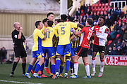 Tempers fray after Woking midfielder Charlie Carter (12) is sent off for his tackle on Accrington Stanley midfielder Sean McConville (11), during the The FA Cup match between Woking and Accrington Stanley at the Kingfield Stadium, Woking, United Kingdom on 4 December 2016. Photo by David Charbit.