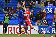 Middlesbrough defender Ryan Shotton (5) battles for possession with Cardiff City striker Kenneth Zohore (10) during the EFL Sky Bet Championship match between Cardiff City and Middlesbrough at the Cardiff City Stadium, Cardiff, Wales on 17 February 2018. Picture by Alan Franklin.