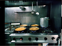 2012.Tossa de Mar, Girona, Spain.Paellas in a kitchen.©Carmen Secanella