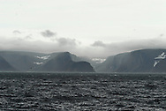 Cliffs and rocky shoreline along the southern part of Baffin Island, on the Hudson Strait. Meta Incognita Peninsula, Southern Baffin Island. Canadian Arctic. Arctic Ocean.