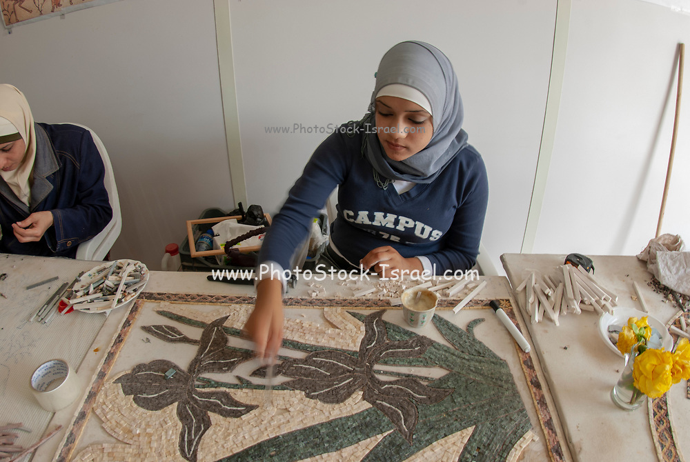 Women make an intricate mosaic design at a mosaic and handicraft workshop, Madaba , Jordan